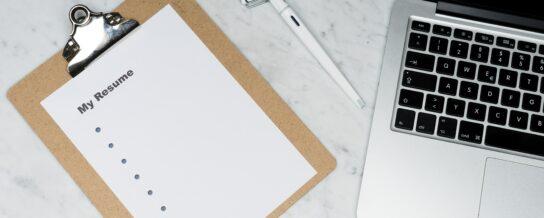 Blank résumé beside a laptop (via unsplash markus-winkler-7iSEHWsxPLw-unsplash-scaled.jpg)